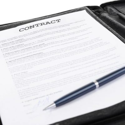 Contract with pen on top